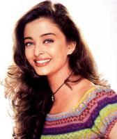 Aishwarya Rai in a colorful top with her long curly hairstyle with straight side bangs