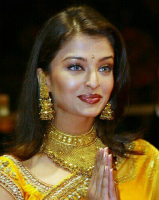 Aishwarya Rai in yellow Indian outfit with her beautiful traditional look.PNG