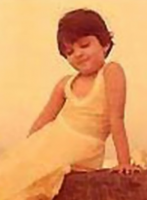 Aishwarya childhood picture_Aishwarya toddler posting for the camrea already.PNG