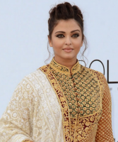 Aishwarya Rai new pictures with gold Indian outfit with her updo.PNG