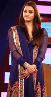 2013 Aishwarya pictures in her long dark purple with orange gold patterns.PNG